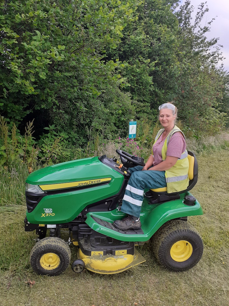 Woman sitting on new mower